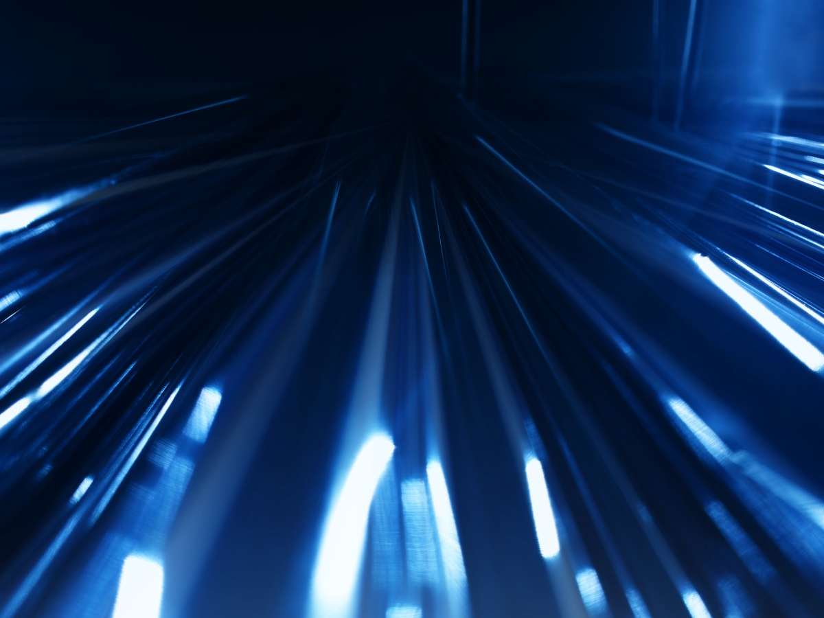 Lichtstrahlen gehen von einem zentralen Punkt aus